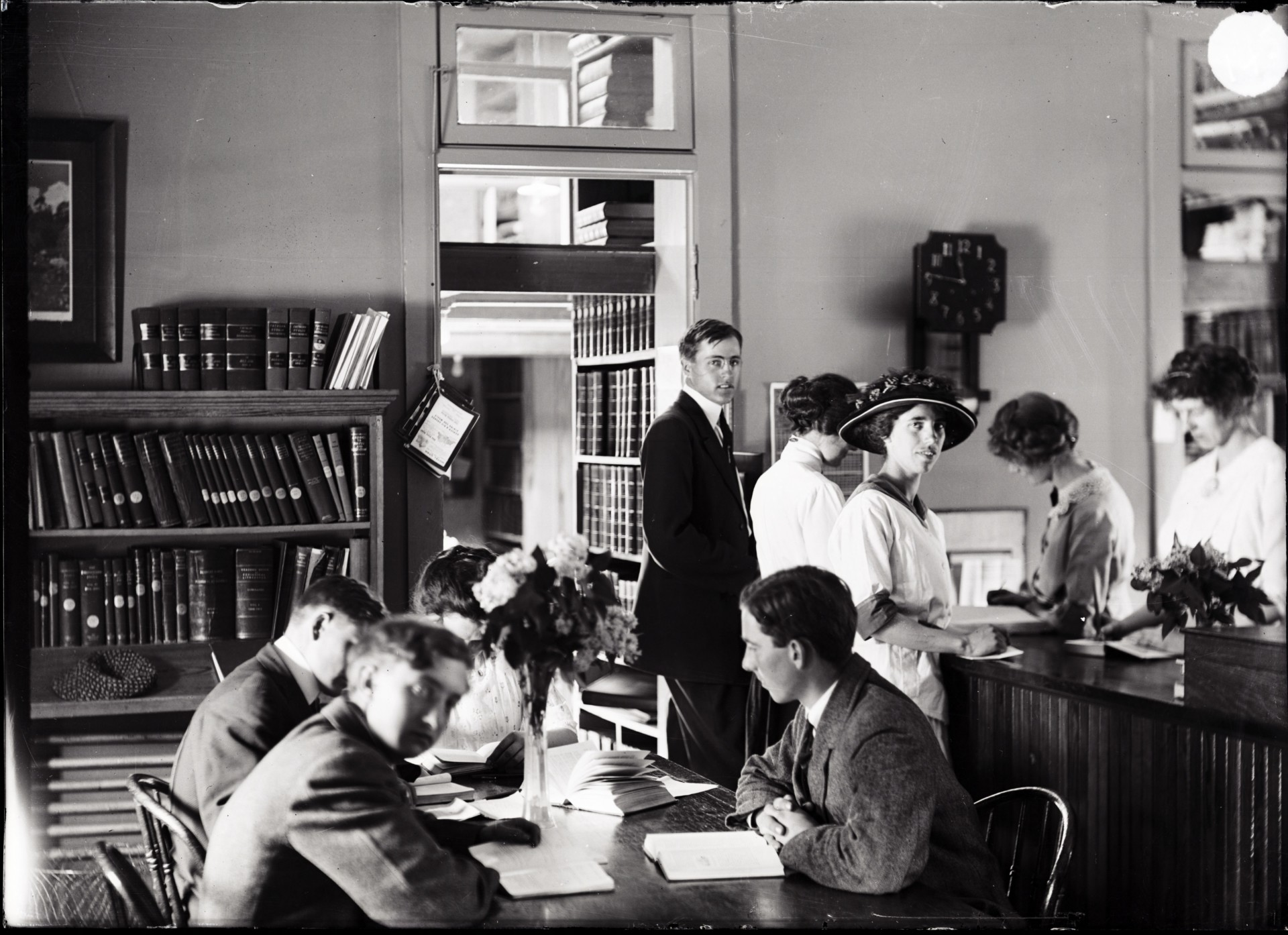 Historic photo of students in the library