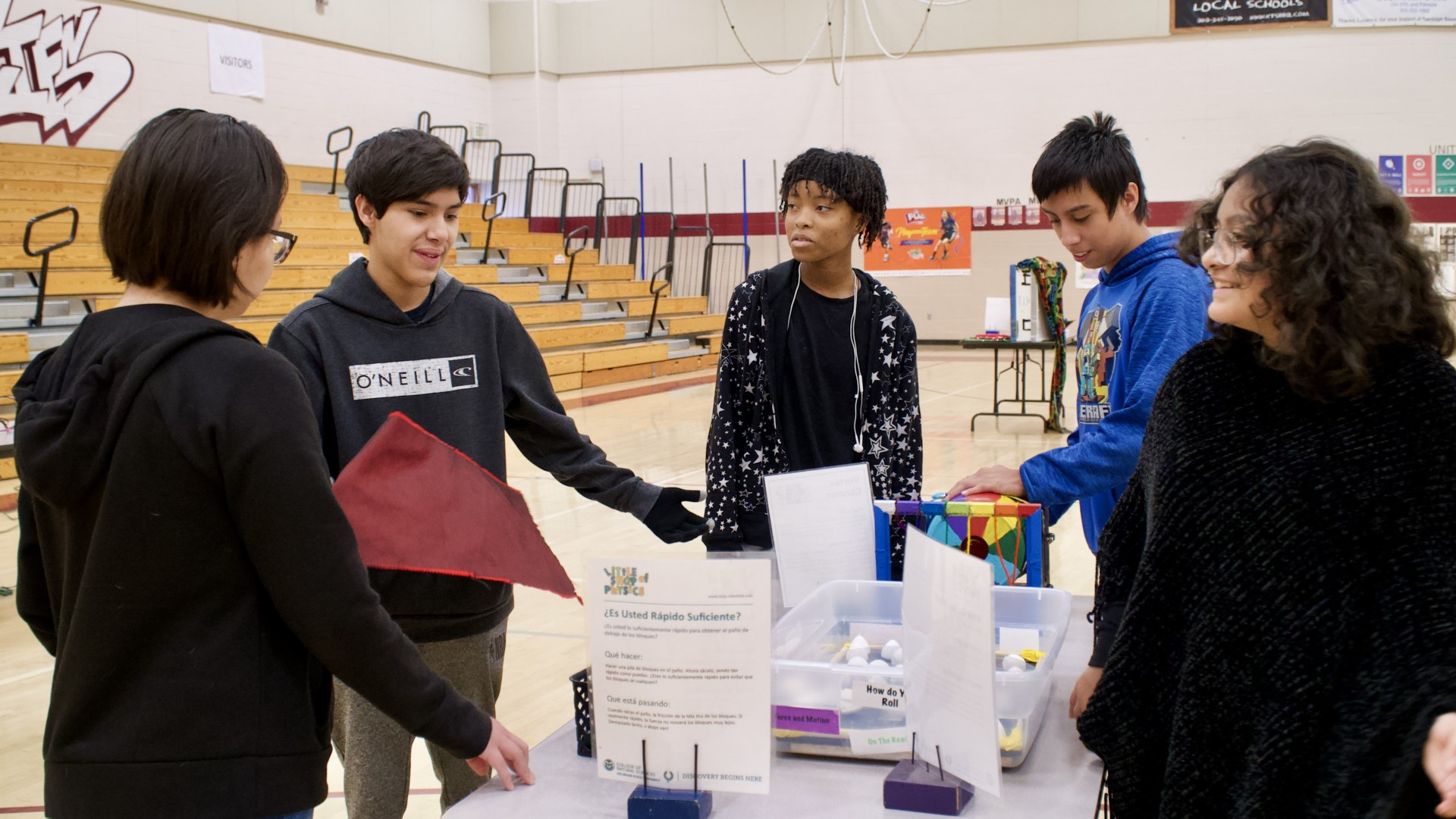 Students participate in Little Shop of Physics science experiments at Bruce Randolph School.