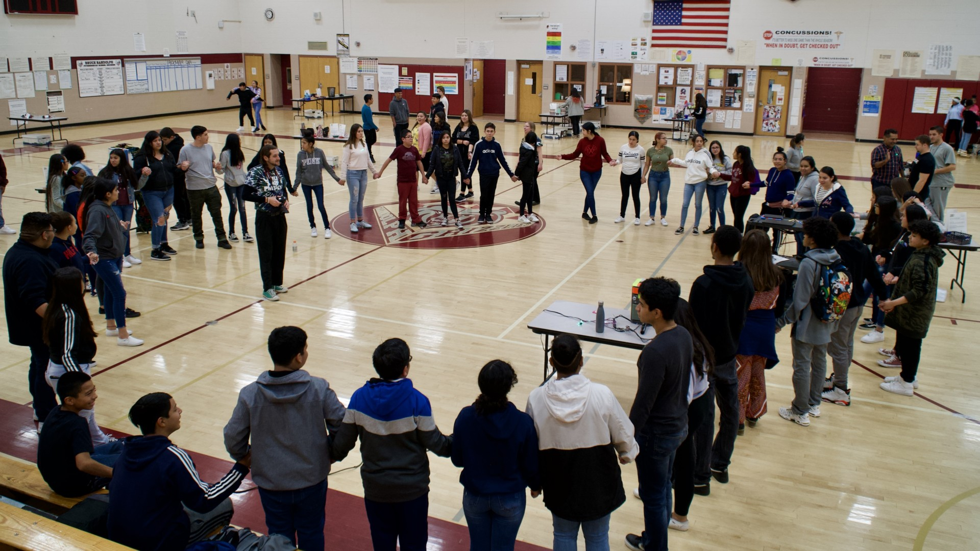Little Shop of Physics 11th-grade mentors from Bruce Randolph School participate in sound connection experiment with large group of younger students.