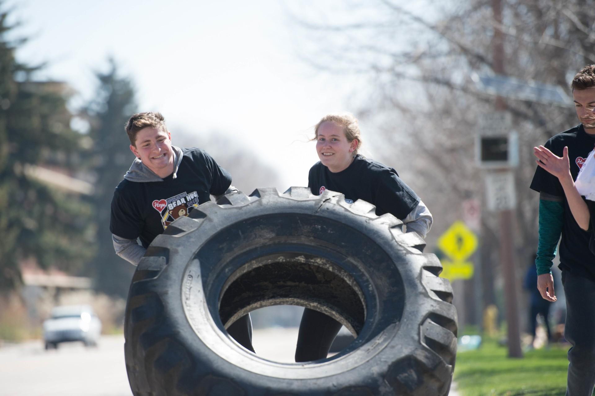 Student veterans moving truck tire