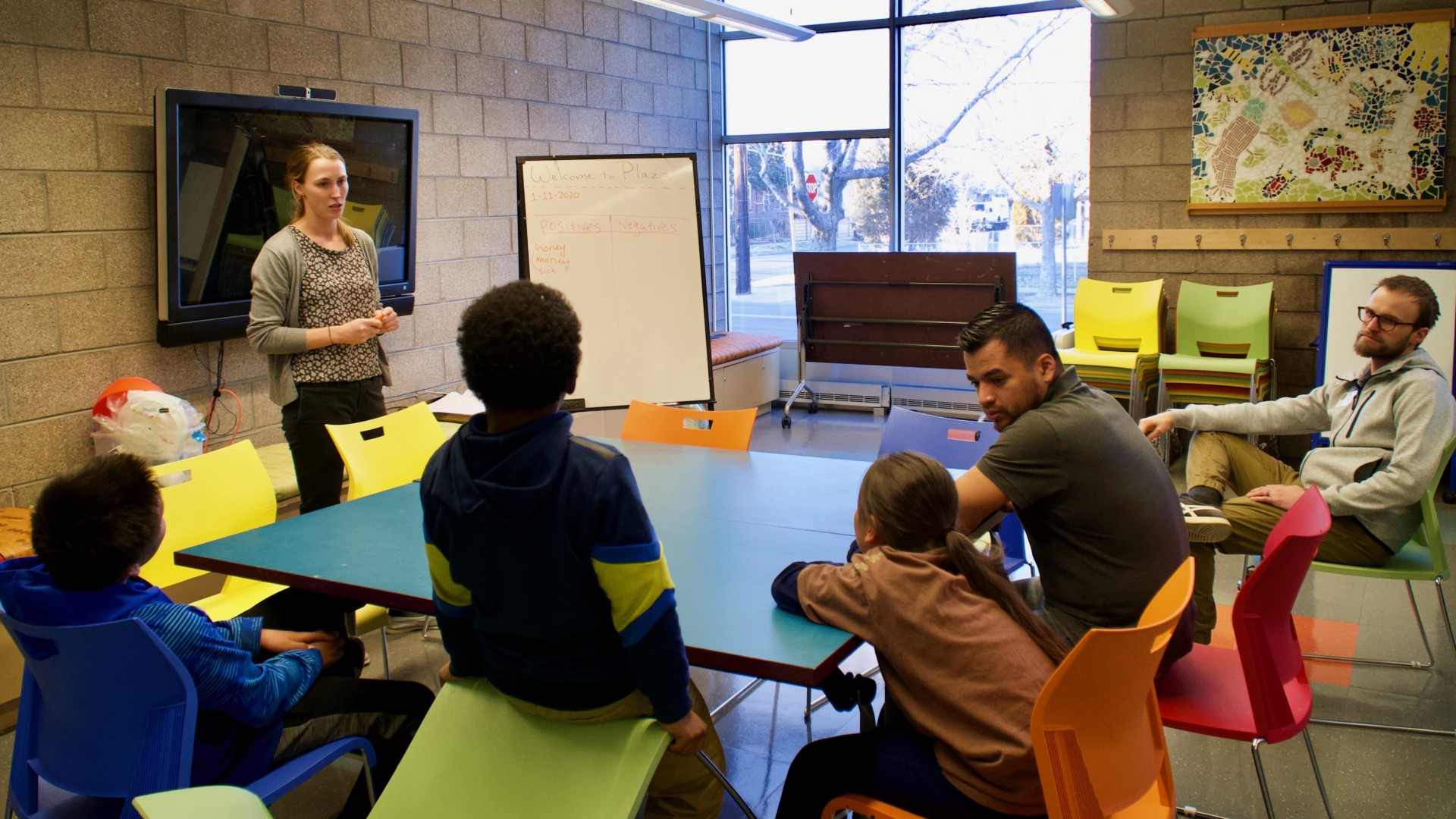 CSU Denver Extension/4-H Agent Merielle Stamm (standing) leads STEM workshop on entomology for youth, with support from Librarian Liam Gray (far-right) and Library Program Associate Armando Pineche Rosales (left of Gray) at Valdez-Perry Branch Library in north Denver.