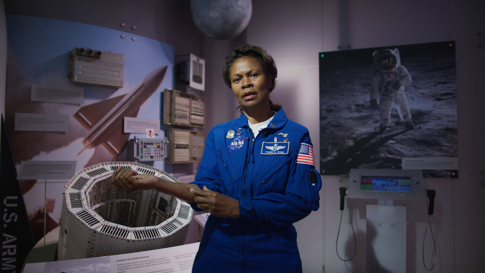 Dr. Yvonne Cagle, NASA astronaut points to her forearm