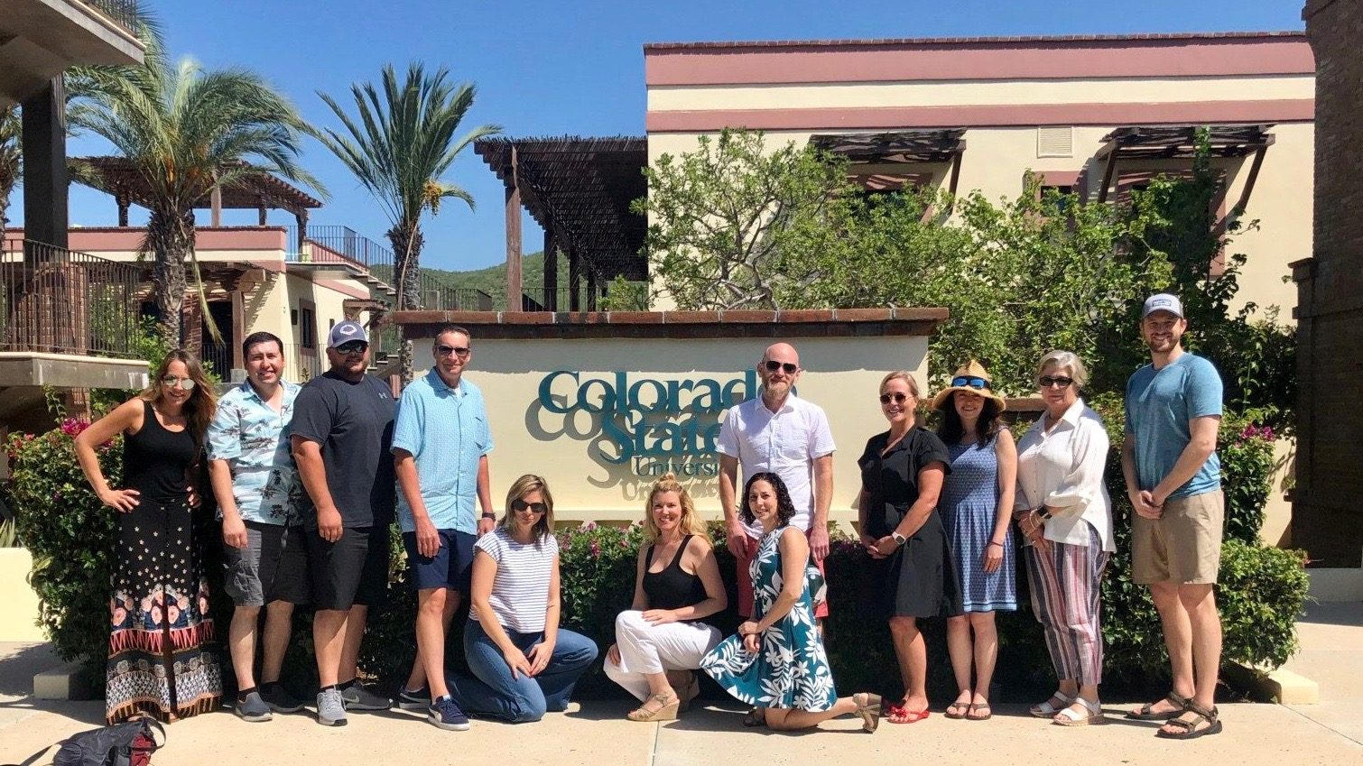 Alumni group gathered around the Colorado State University sign on the Todos Santos Center campus.