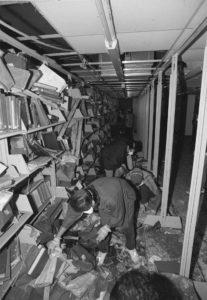 Shelves of damaged books