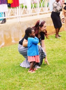 Maya Roberts at with a child at Kenyan Clubfoot Hospital