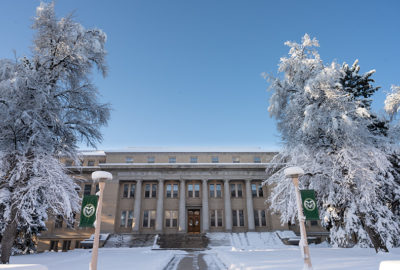 The sun comes up after a heavy spring snow blankets campus, April 17, 2020