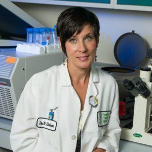 Nicole Ehrhart in her lab at CSU