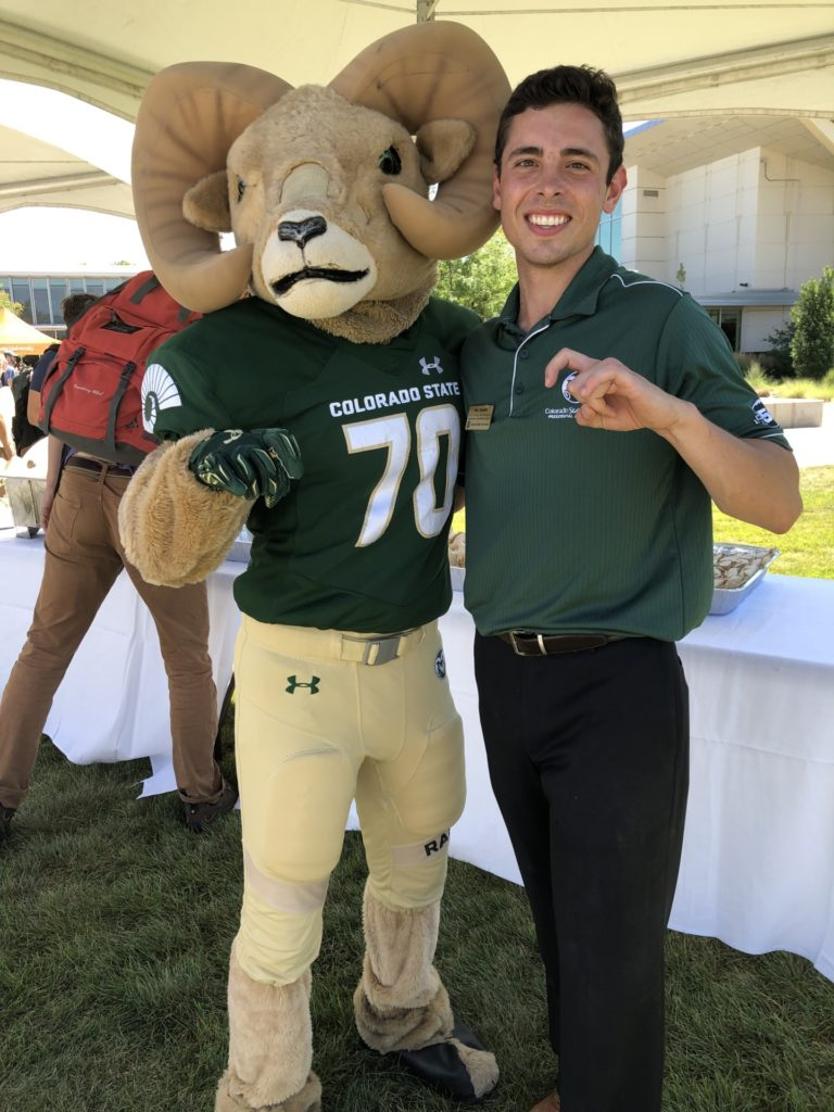 A student with CSU mascot Cam