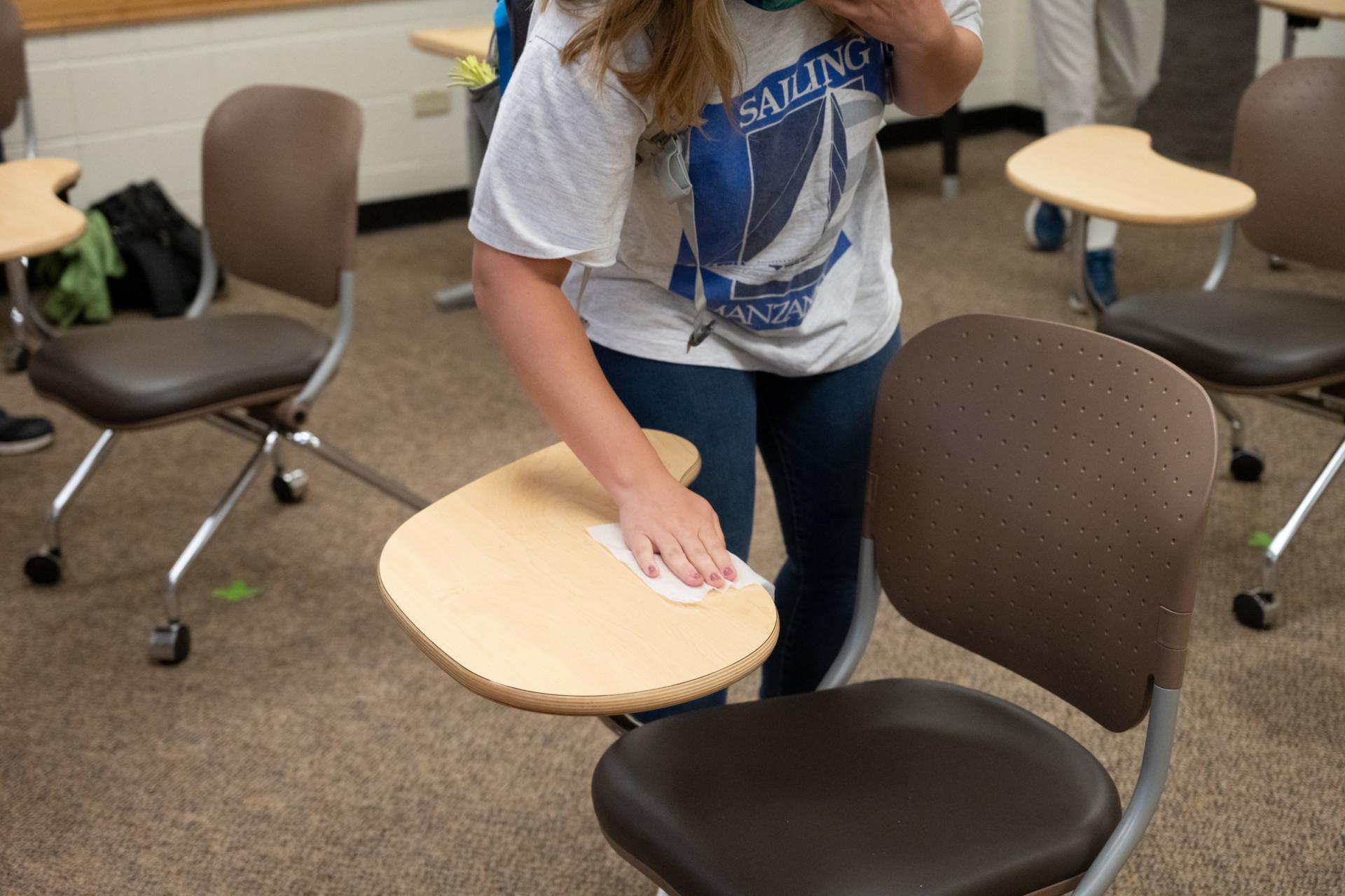 Student using wipe