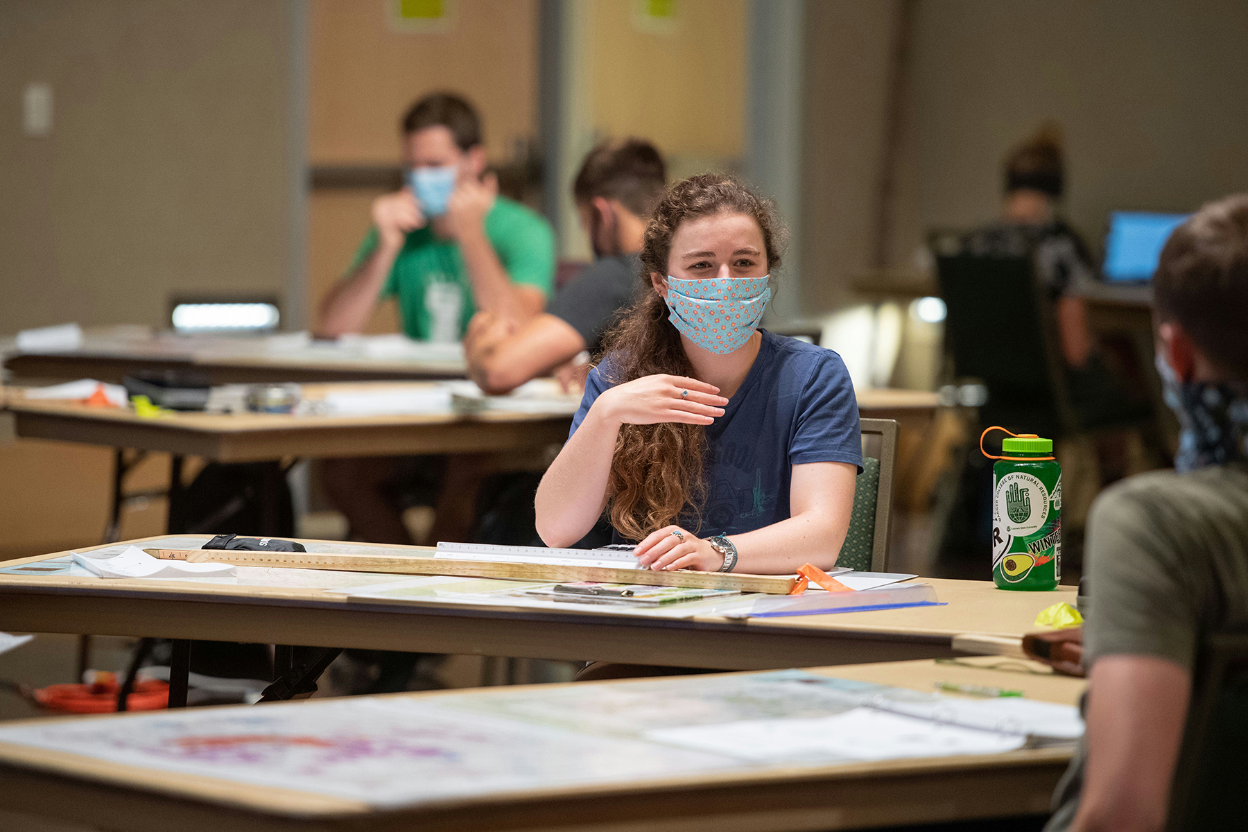 A student, wearing a mask in keeping with health policies, attends a socially distanced forestry class at CSU in Fort Collins earlier this month. Photo: John Eisele / Colorado State University