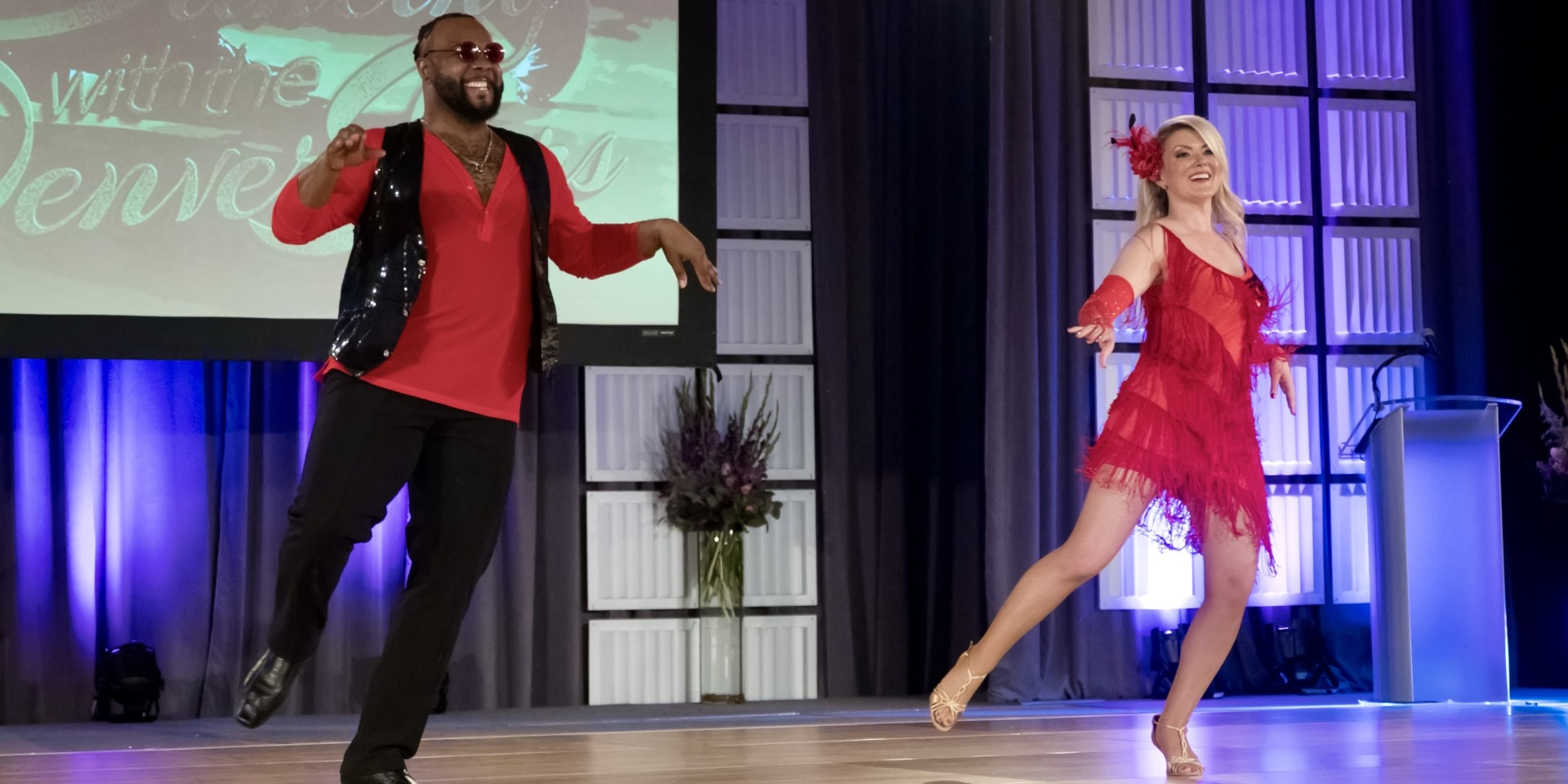 CSU System executive vice chancellor Amy Parsons performs routine with Cleo Parker Robinson Dance coach Cedric Hall at the Dancing with the Denver Stars fundraiser, Aug. 25, 2018.