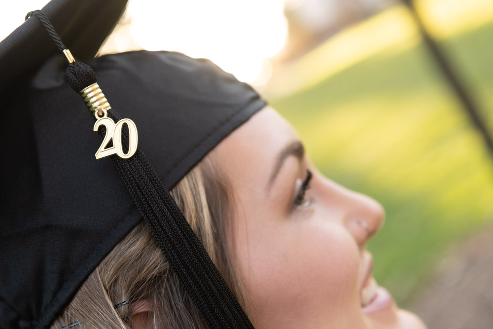 Graduate with 20 on mortarboard