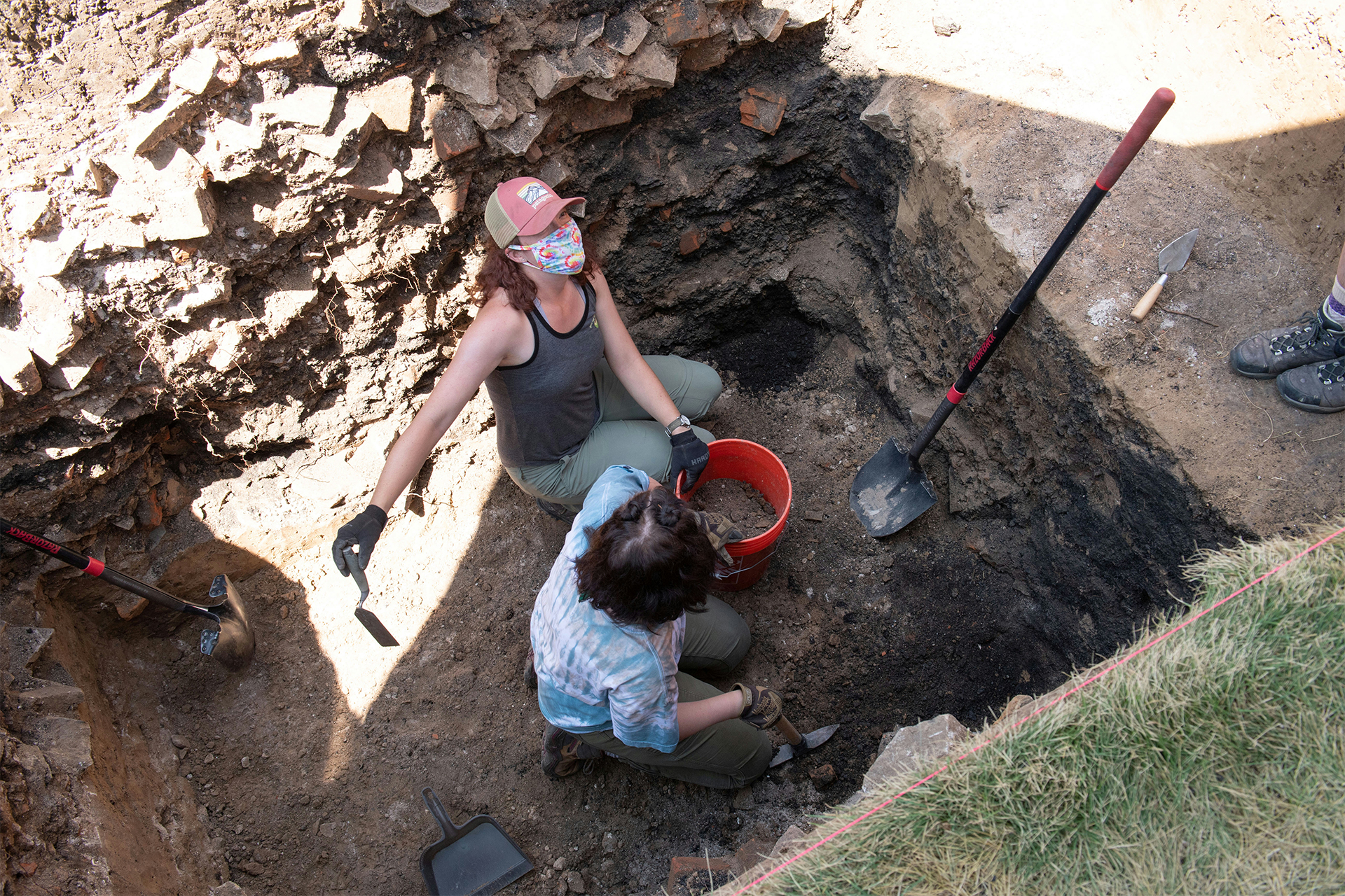 Archaeology students participate in a dig at the corner of Laurel Street and College Avenue to locate the Claim Building.