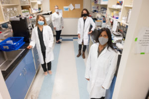researcher Elizabeth Ryan and her team in the lab at Colorado State University