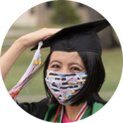 Student graduating holding on to cap