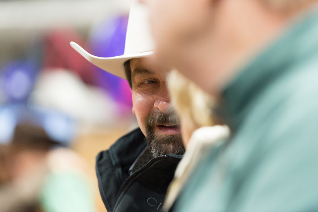 Chacnellor Tony Frank wearing a cowboy hat at the National Western Stock Show