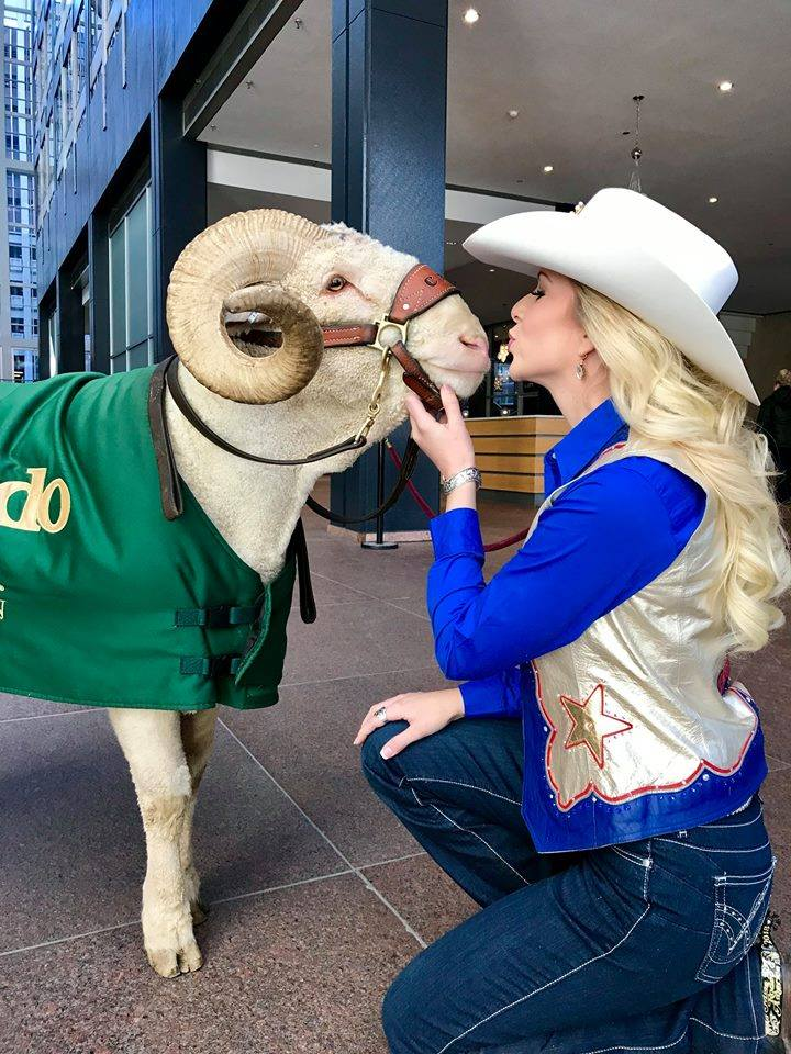 Miss Rodeo Colorado gives CAM the Ram a kiss.