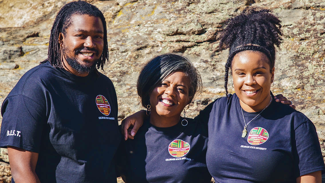 Former B/AACC director Bridgette Johnson (center) poses with colleagues Adrian Jones (left) and Emerald Green (right) on one of the Center's outdoor outings.
