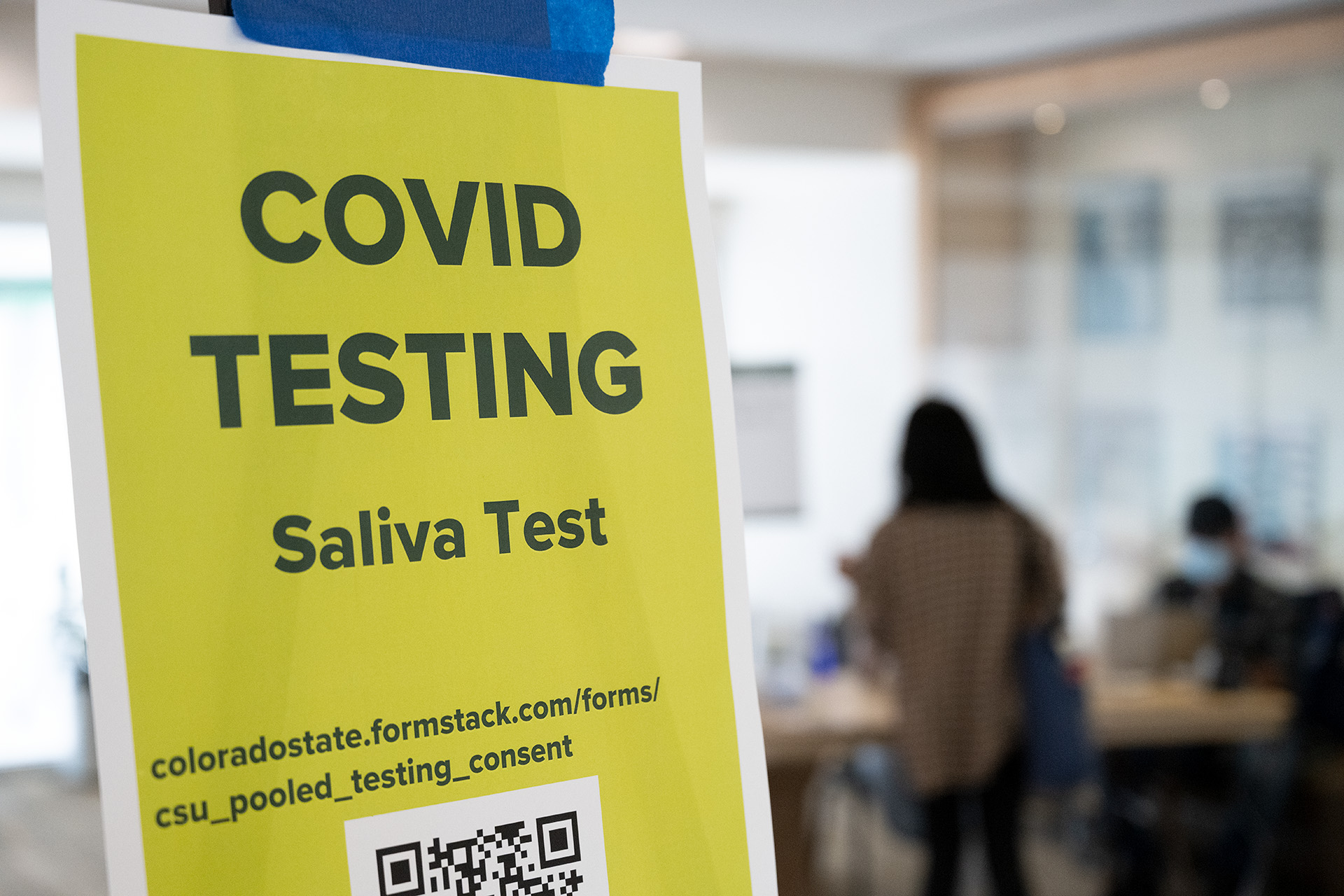 Sign for COVID saliva test
