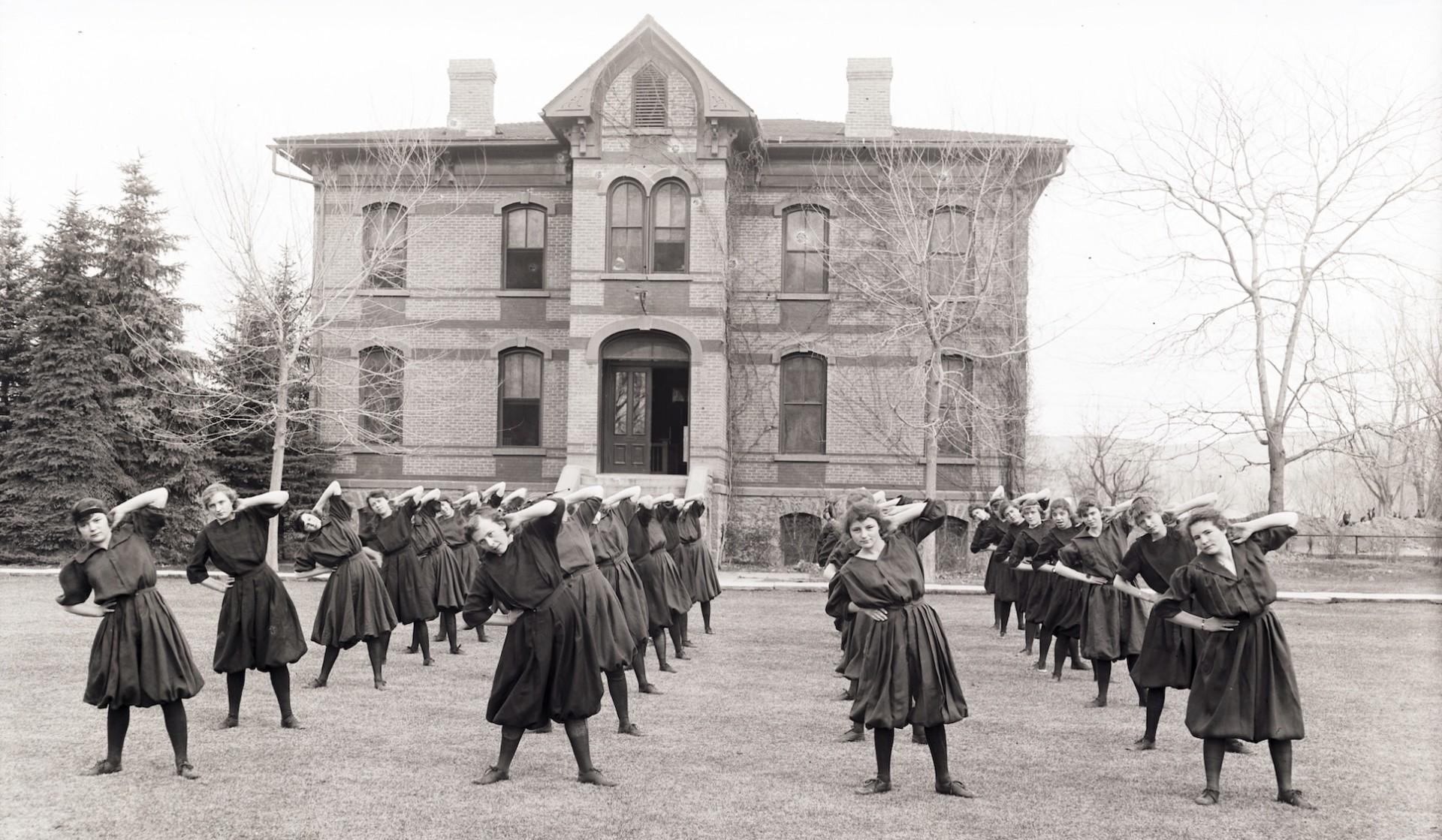 Women exercising outside Spruce Hall 1915-16