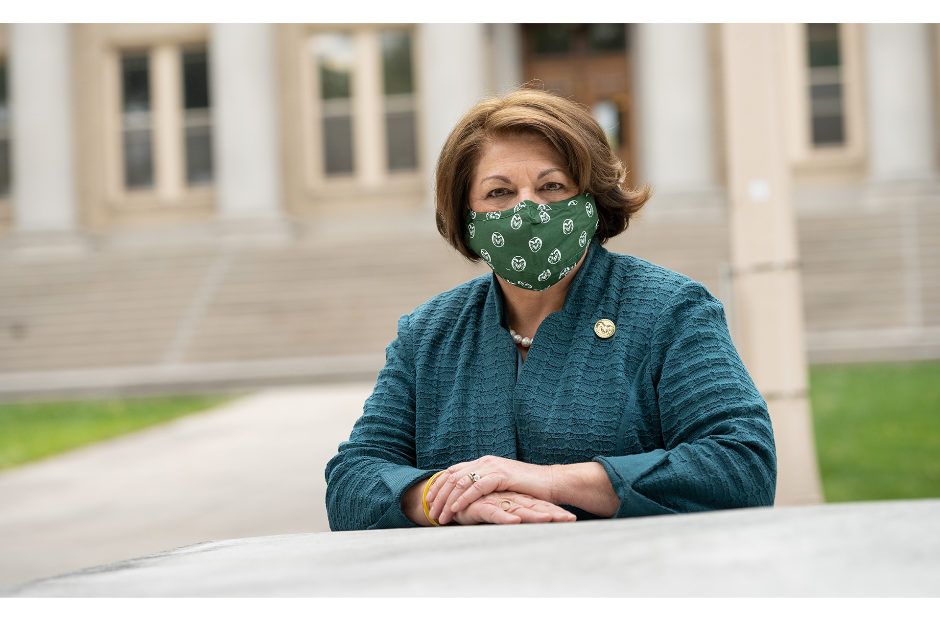 Joyce McConnell wearing a face covering