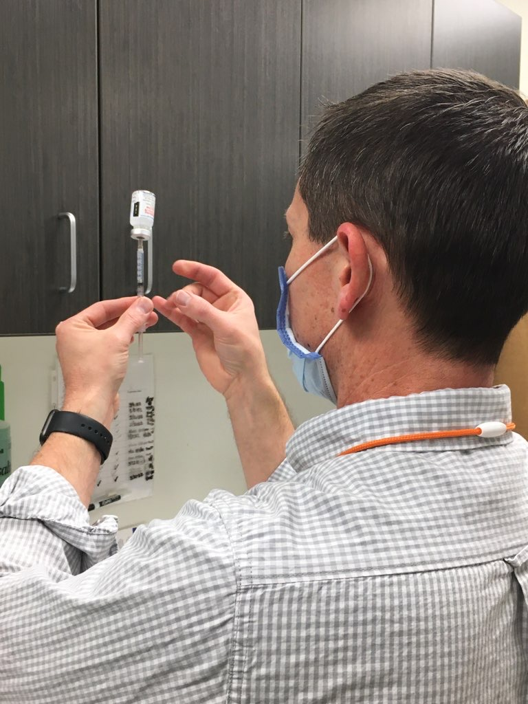 Medical worker with syringe