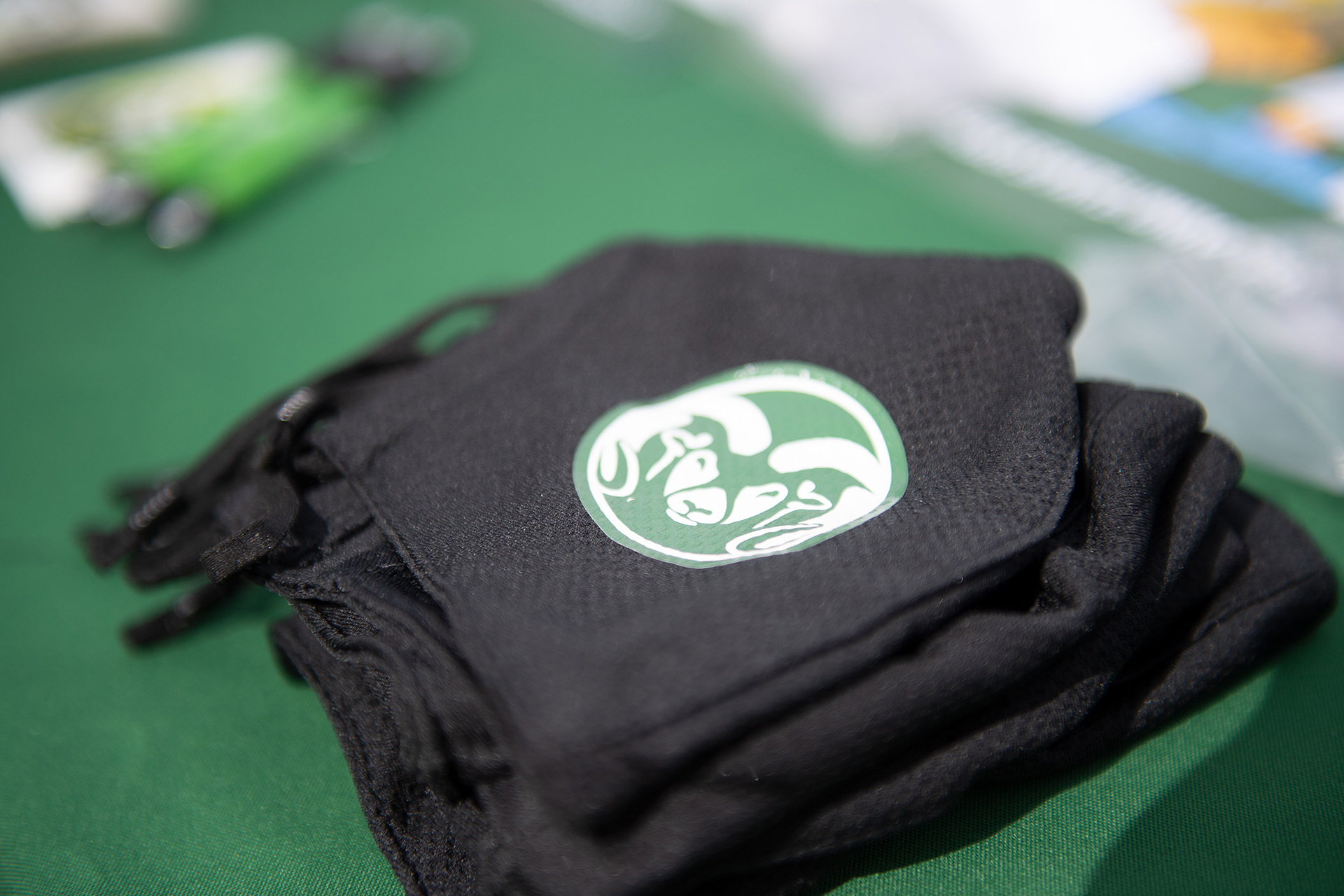 Black CSU face covering with green CAM the Ram logo