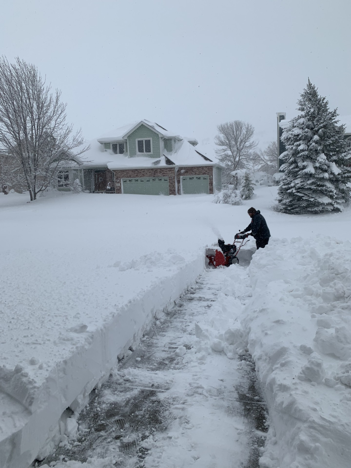 Man with snow blower, March 14, 2021