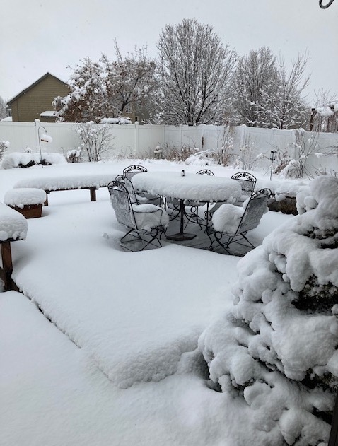 Patio furniture in snow March 14, 2021