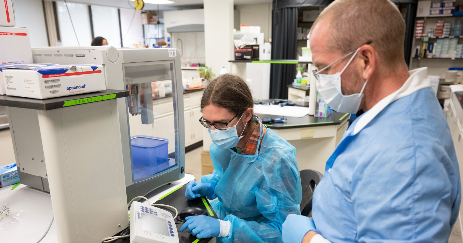 researchers in lab wearing masks