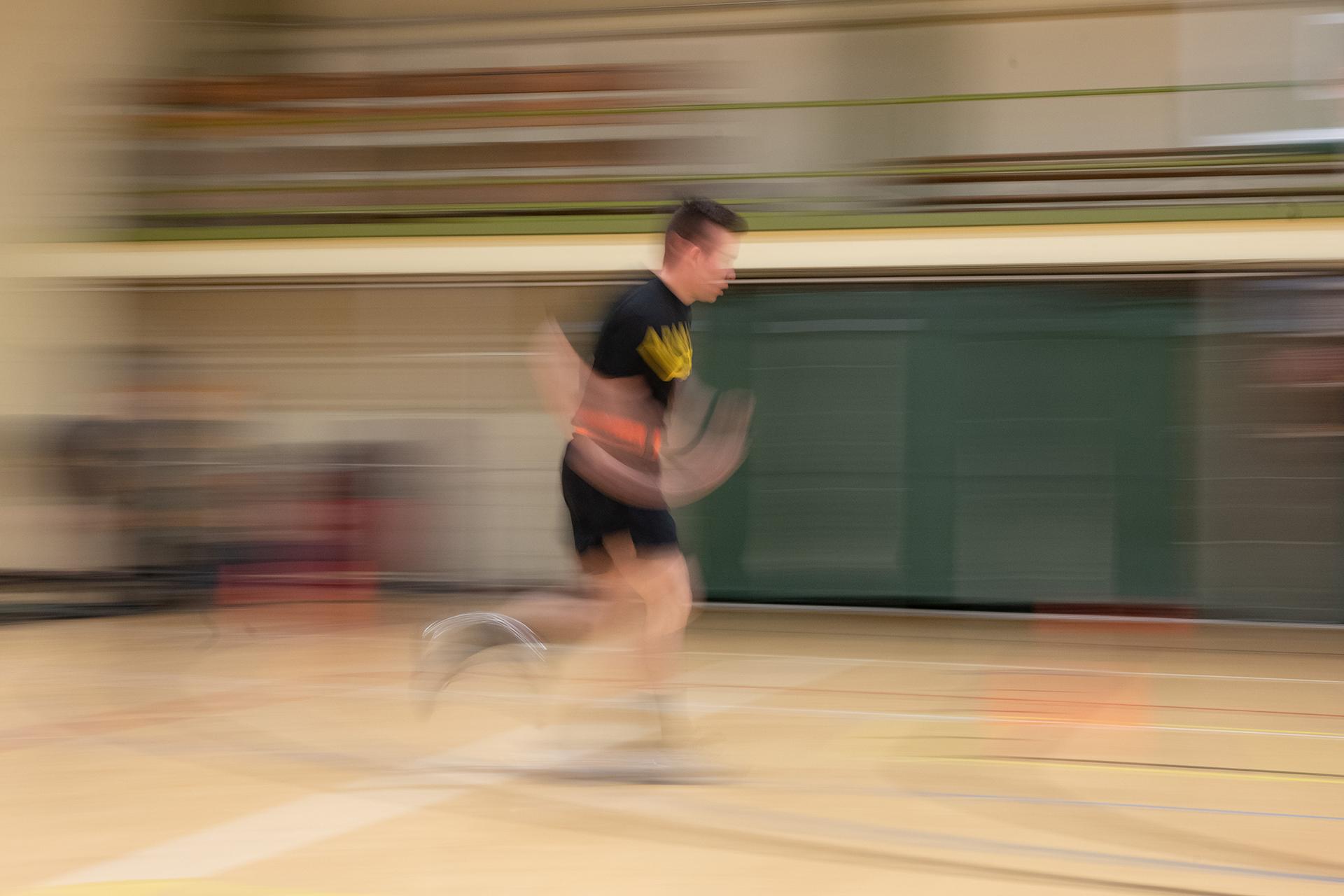 CSU Army ROTC cadet running in gym