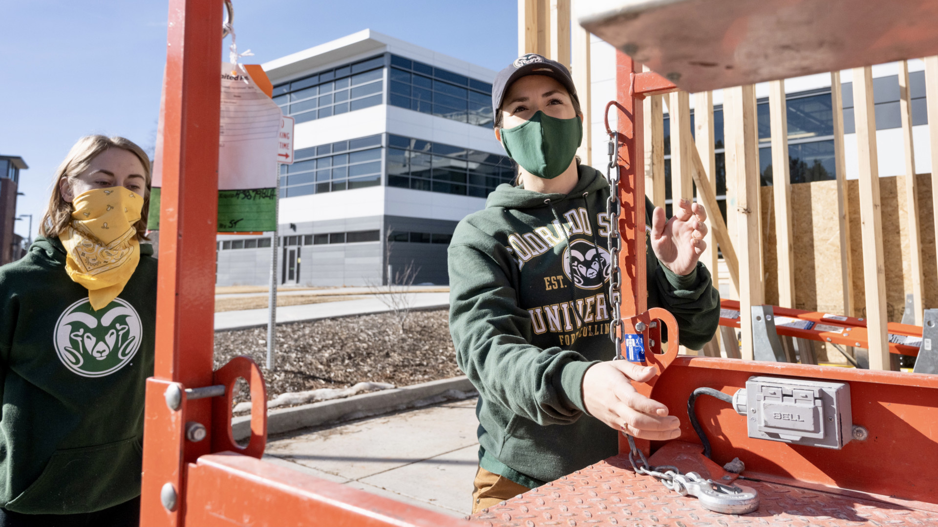 Maria Delgadostands next to student while assisting in the construction of a tiny house on wheels at the Nancy Richardson Design Center, March 6, 2021.