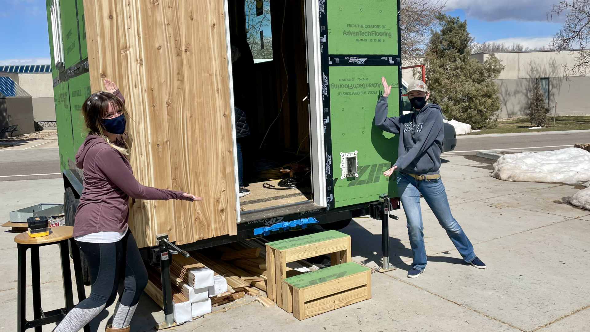 Interior Architecture and Design students Nina Struble (left) and Emmalyne Axtell in front of the Tiny House on Wheels, March 27, 2021.