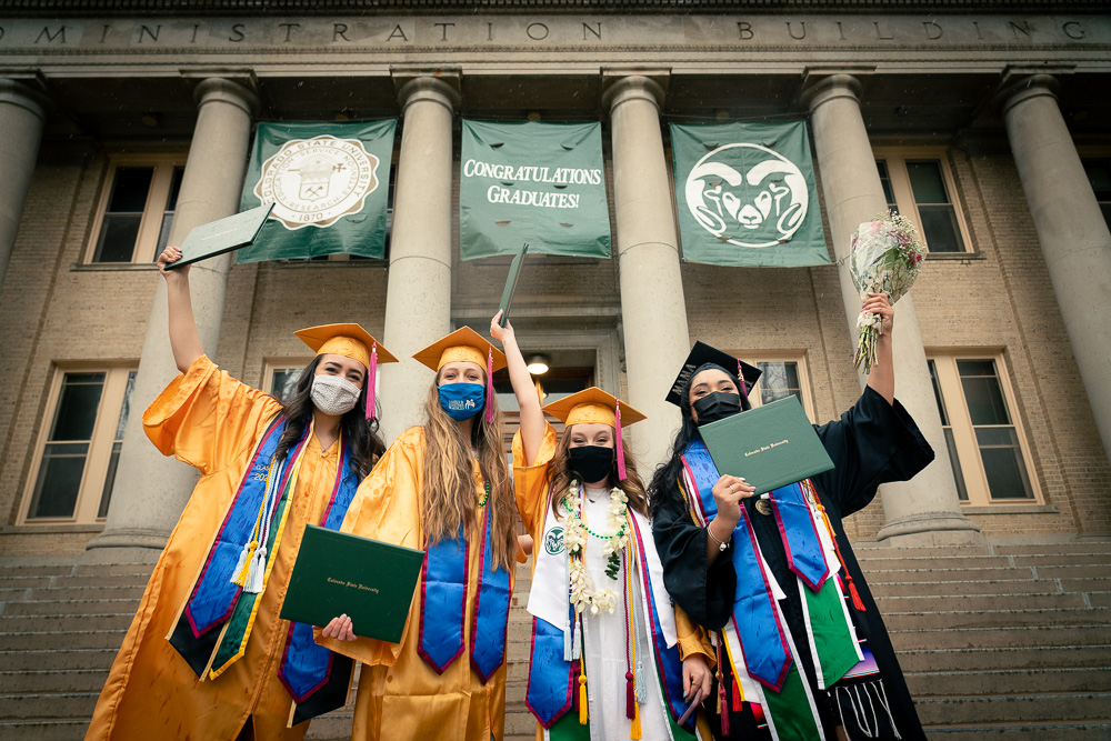 Graduates celebrating in front of the CSU Administration Building