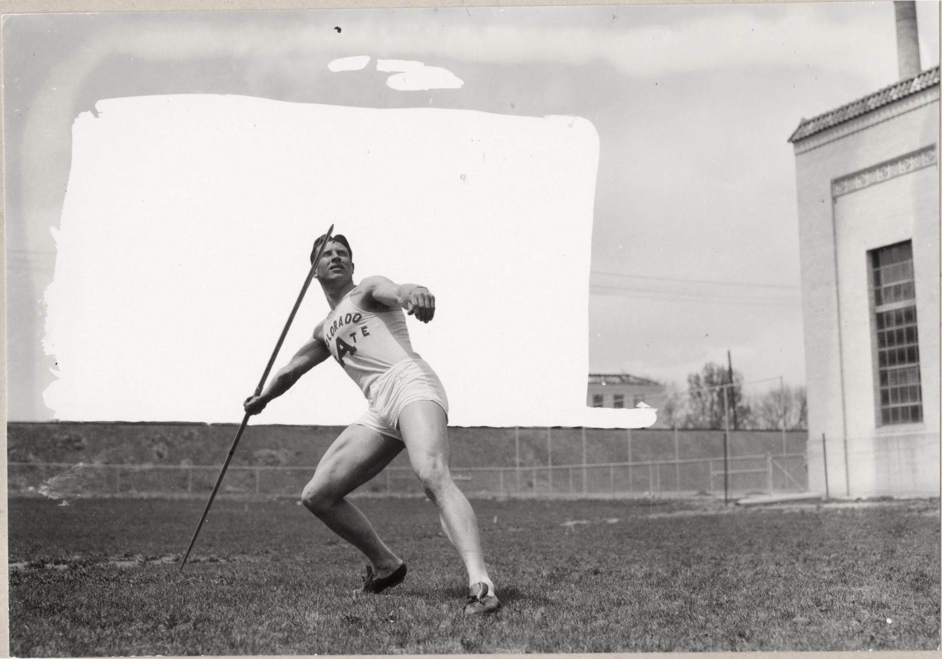 Glenn Morris throwing a javelin