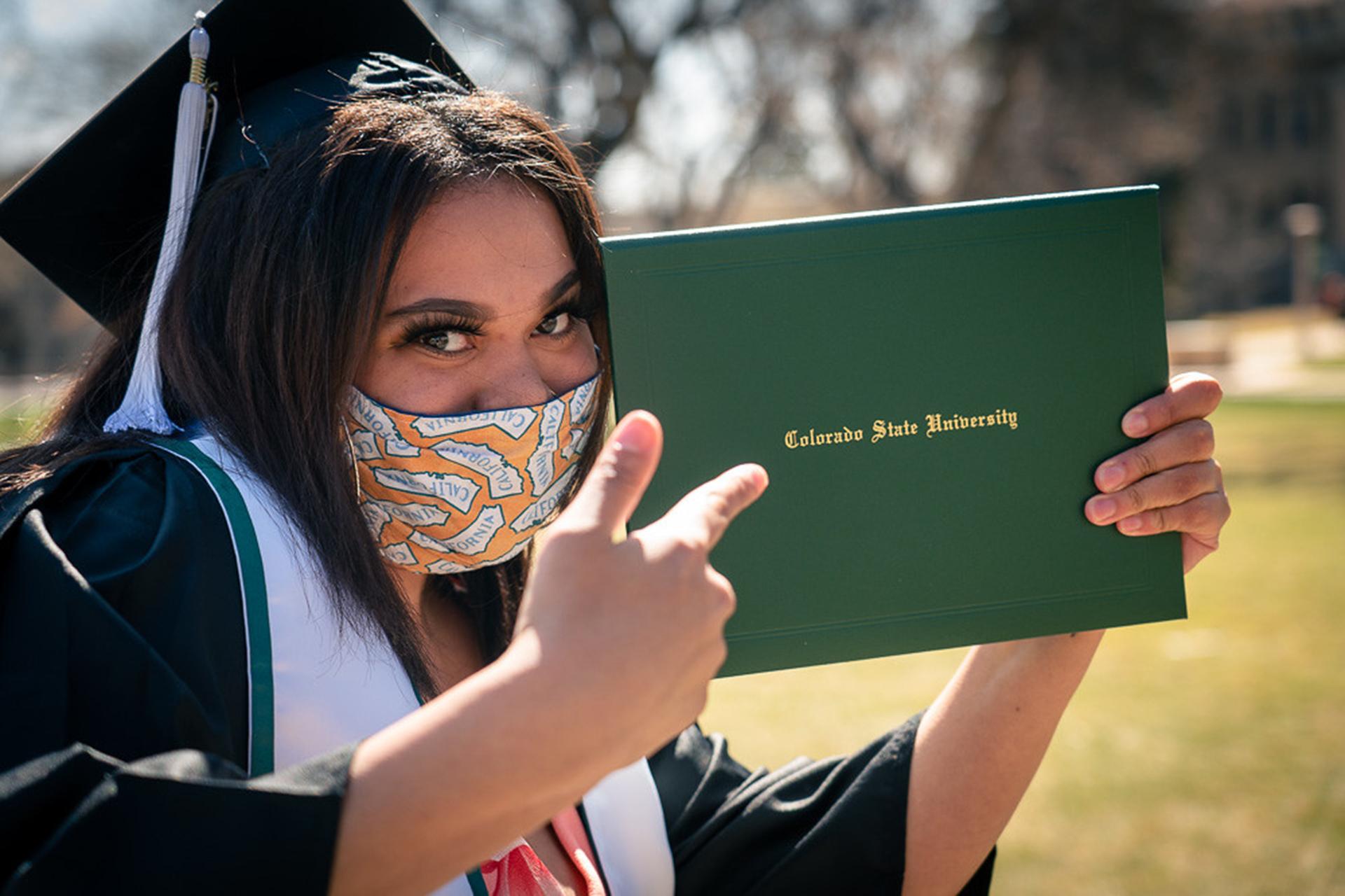 CSU student holding diploma