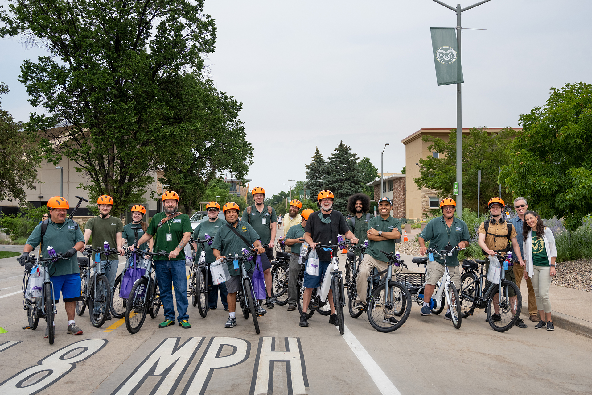 A group of CSU employees with their e-bikes