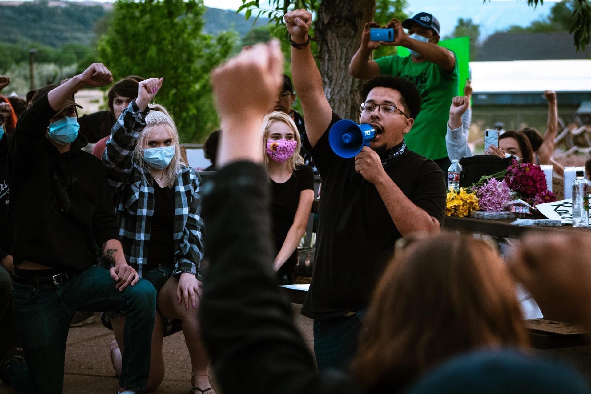 Alan Muñoz Valenciano at a rally in Colorado